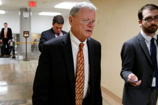 Inhofe is greeted by a reporter